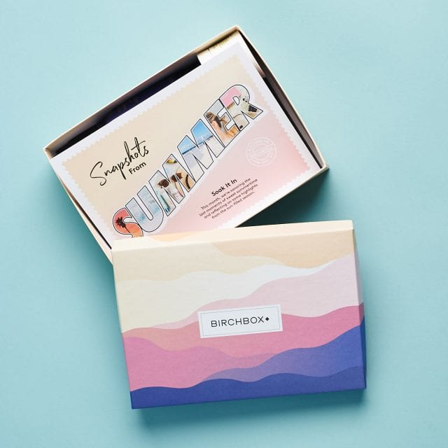 Birchbox branded container opened to show a stack of post cards
