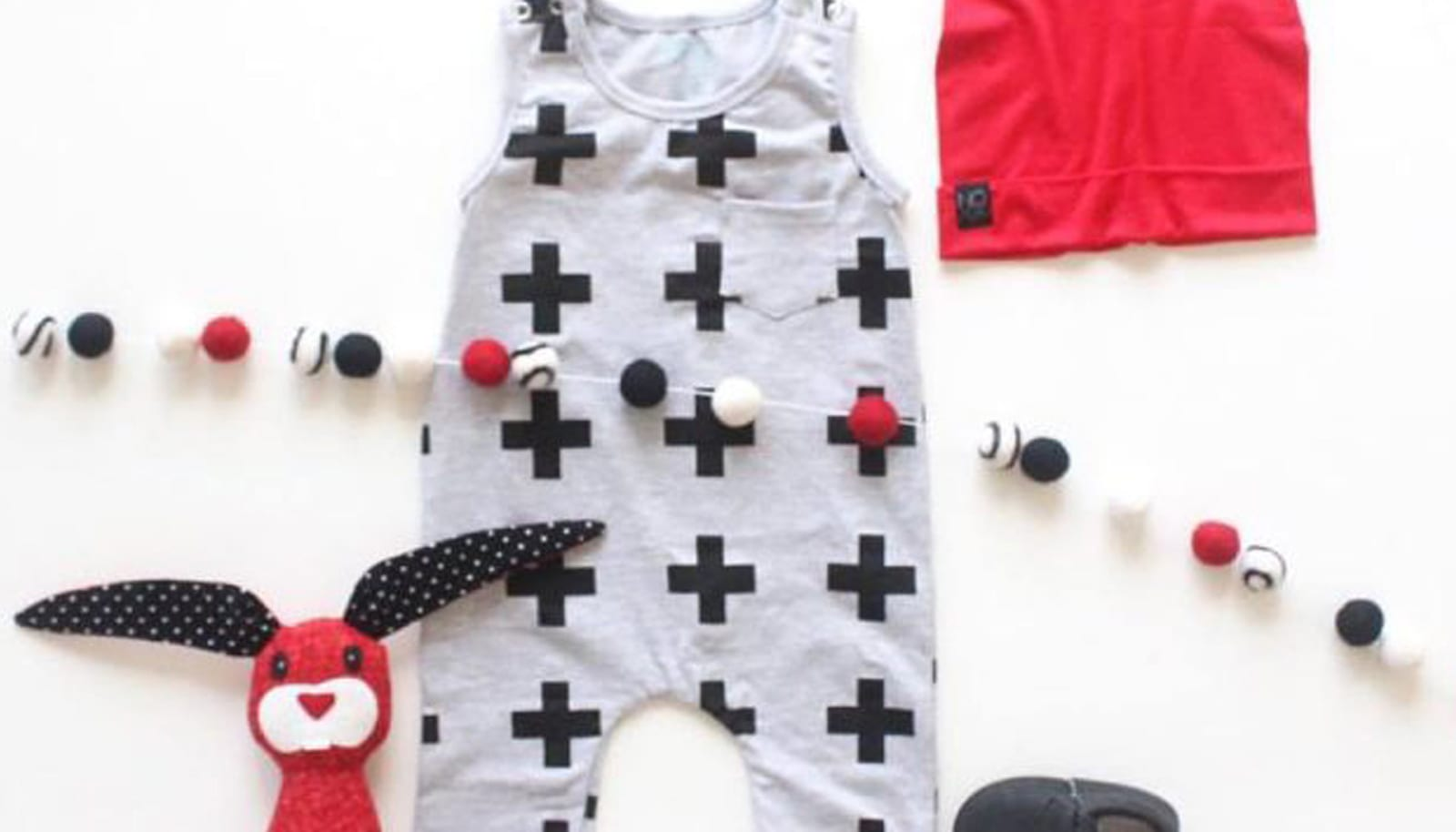 a collection of children's clothes laid out in grid like fashion