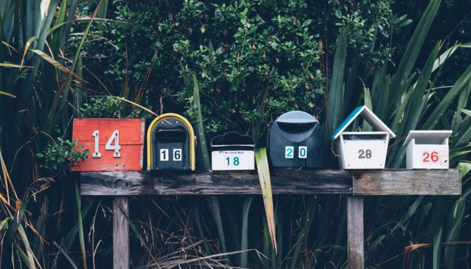 a row of quirky mailboxes