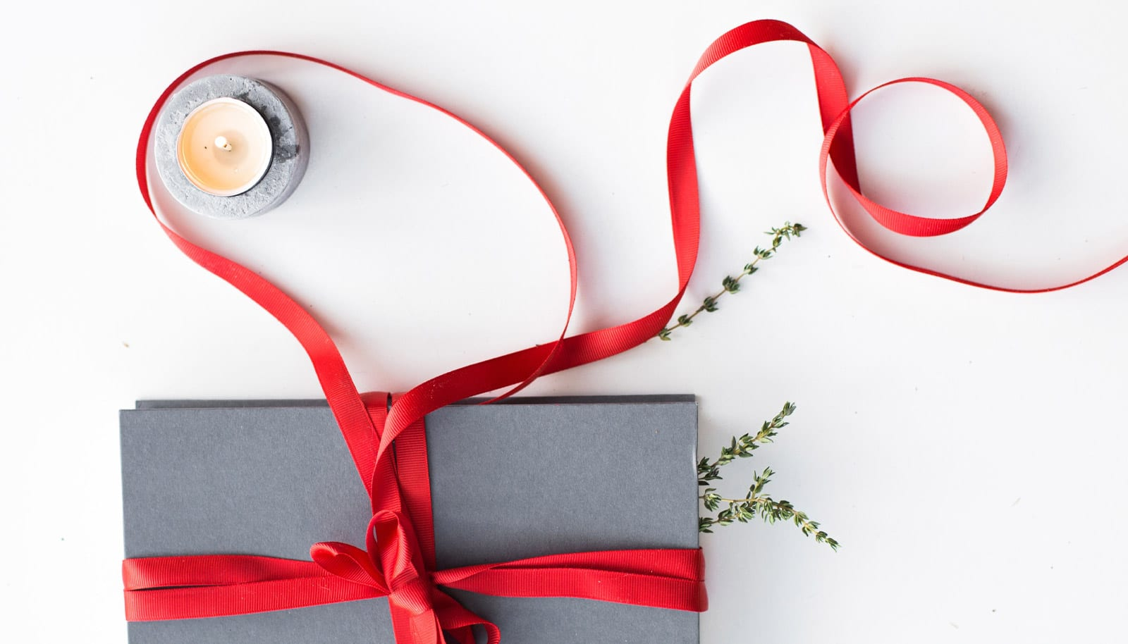 top view of gift accented with red ribbon