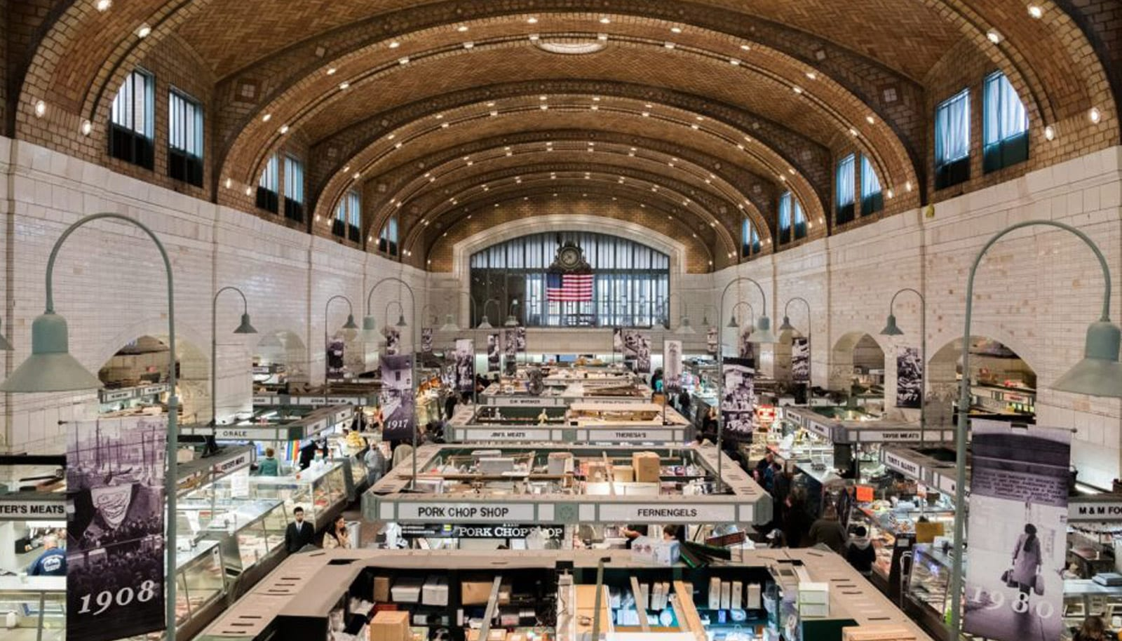large indoor marketplace with historic architectural structures