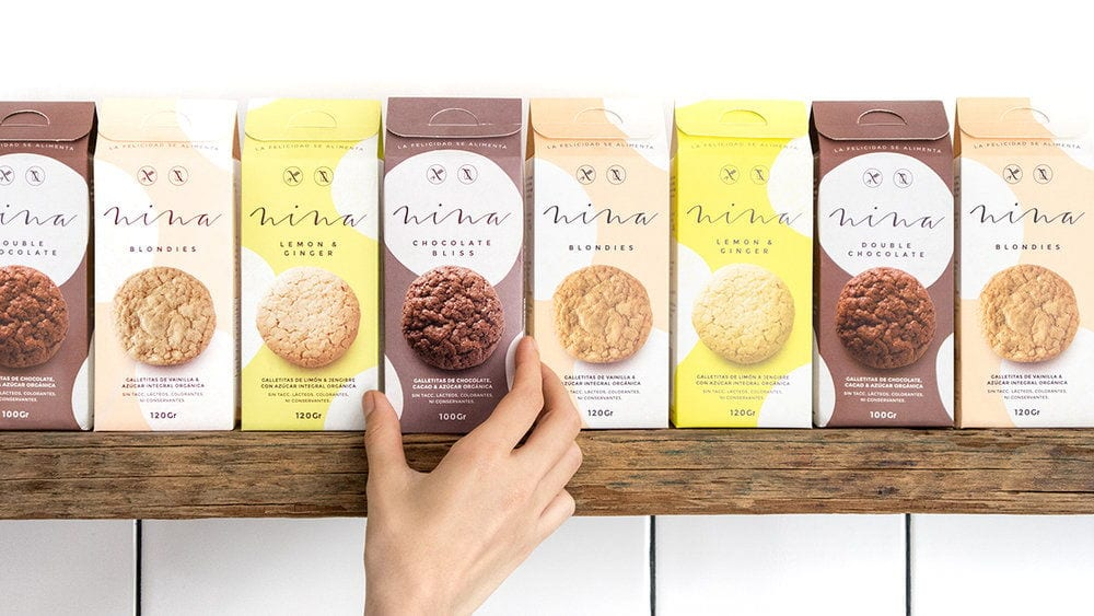 A row of cookie packaging, showing bright backgrounds and beautiful photography of a cookie on each